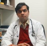 Dr. Karun Behal